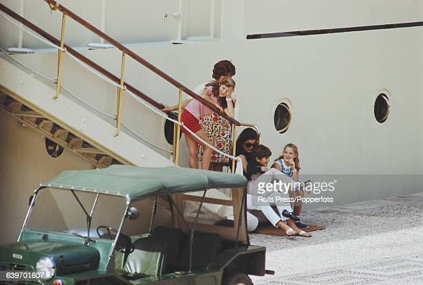 Former First Lady of the United States Jacqueline Kennedy Onassis pictured with her children John Jr and Caroline on the day before her wedding to...
