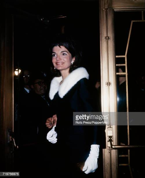 Former First Lady of the United States Jacqueline Kennedy pictured wearing a black coat with white fur collar and matching white gloves as she...