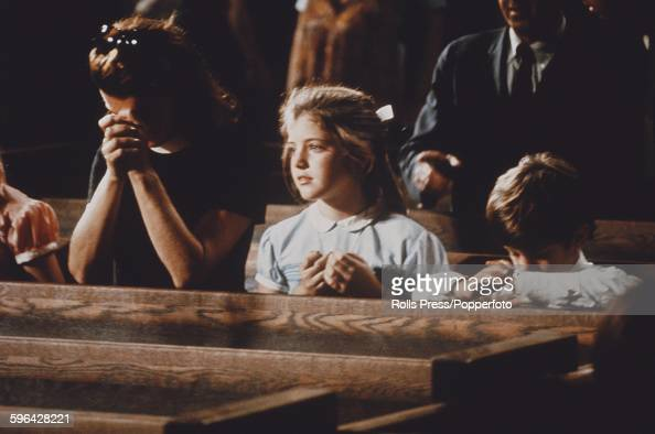 Former First Lady of the United States Jacqueline Kennedy pictured with her children Caroline Kennedy and John F Kennedy Jr as they attend the...