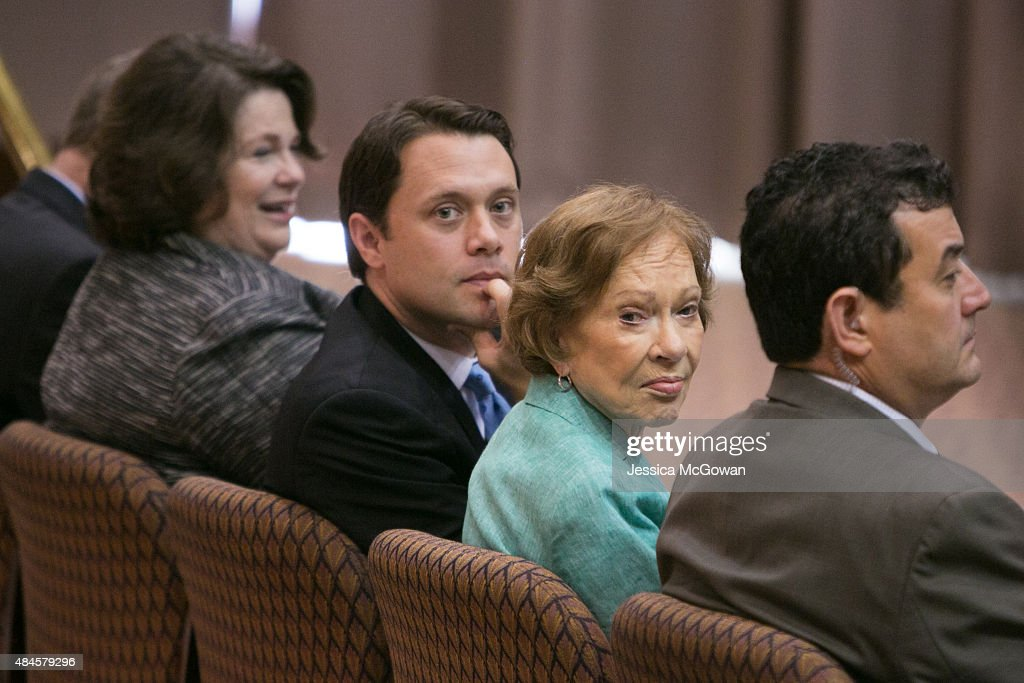 Former first lady Rosalynn Carter and grandson, Jason Carter, listen to President Jimmy Carter discuss his cancer diagnosis during a press conference at the Carter Center August 20, 2015 in Atlanta, Georgia. President Carter confirmed that he has melanoma that has spread to his liver and brain and will start treatment today.
