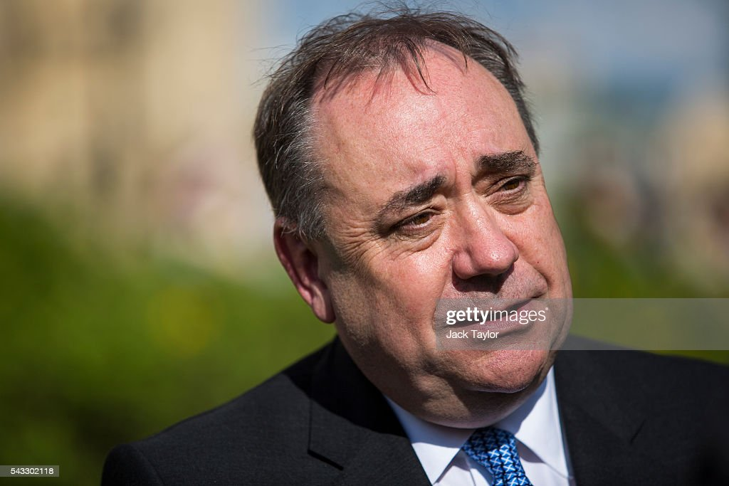 Former First Minister of Scotland <a gi-track='captionPersonalityLinkClicked' href=/galleries/search?phrase=Alex+Salmond&family=editorial&specificpeople=857688 ng-click='$event.stopPropagation()'>Alex Salmond</a> during a television interview on College Green in Westminster on June 27, 2016 in London, England. British Prime Minister David Cameron chaired an emergency Cabinet meeting this morning, after Britain voted in a referendum to leave the European Union. Various members of Labour's shadow cabinet have today quit over an apparent lack of confidence in Jeremy Corbyn's leadership of the party during the referendum campaign.