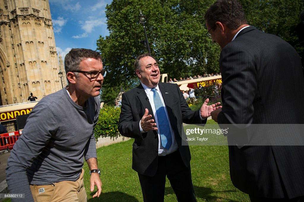Former First Minister of Scotland <a gi-track='captionPersonalityLinkClicked' href=/galleries/search?phrase=Alex+Salmond&family=editorial&specificpeople=857688 ng-click='$event.stopPropagation()'>Alex Salmond</a> (C) gestures during a television interview on College Green in Westminster on June 27, 2016 in London, England. British Prime Minister David Cameron chaired an emergency Cabinet meeting this morning, after Britain voted in a referendum to leave the European Union. Various members of Labour's shadow cabinet have today quit over an apparent lack of confidence in Jeremy Corbyn's leadership of the party during the referendum campaign.