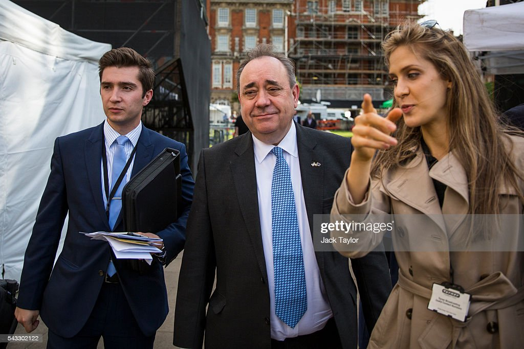 Former First Minister of Scotland <a gi-track='captionPersonalityLinkClicked' href=/galleries/search?phrase=Alex+Salmond&family=editorial&specificpeople=857688 ng-click='$event.stopPropagation()'>Alex Salmond</a> (C) is seen before a television interview on College Green in Westminster on June 27, 2016 in London, England. British Prime Minister David Cameron chaired an emergency Cabinet meeting this morning, after Britain voted in a referendum to leave the European Union. Various members of Labour's shadow cabinet have today quit over an apparent lack of confidence in Jeremy Corbyn's leadership of the party during the referendum campaign.