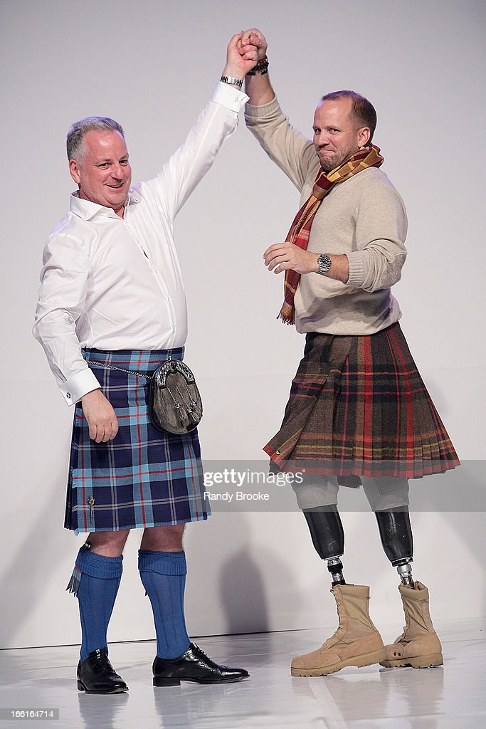 Former First Minister of Scotland <a gi-track='captionPersonalityLinkClicked' href=/galleries/search?phrase=Jack+McConnell&family=editorial&specificpeople=227028 ng-click='$event.stopPropagation()'>Jack McConnell</a> and Seargent Dan Nevins raise their arms in celebration during the 2013 From Scotland With Love Charity Fashion Show at Stage 48 on April 8, 2013 in New York City.