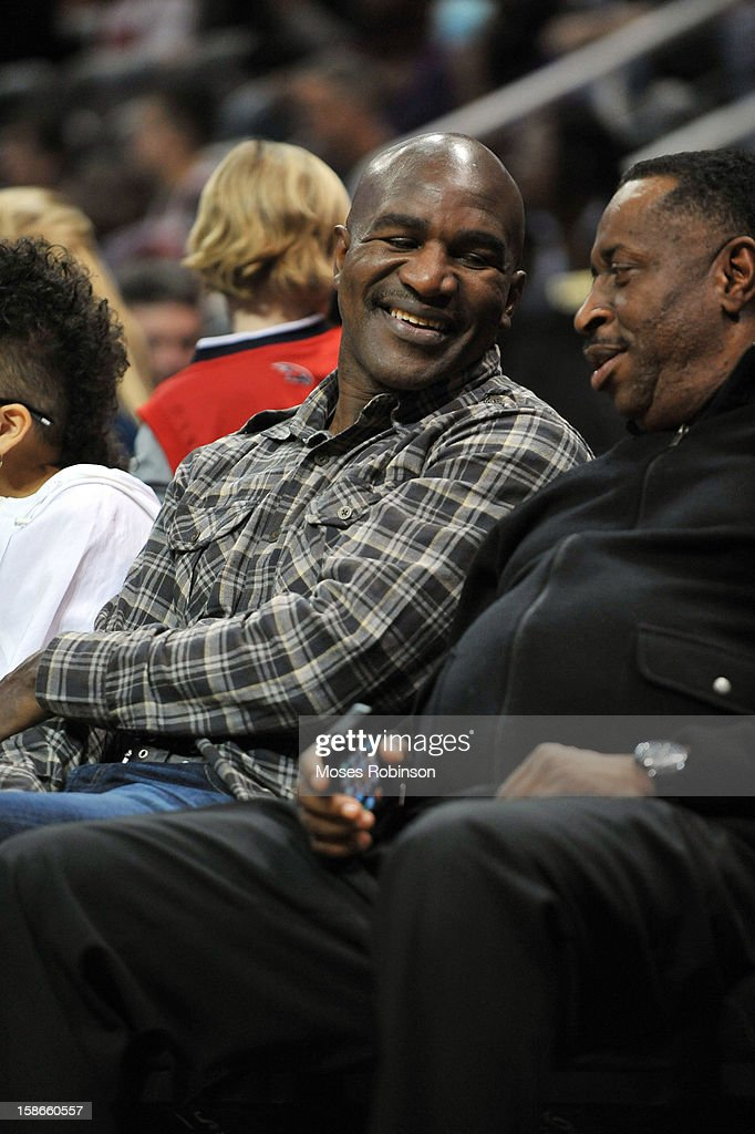 Former Five-time world heavyweight champion Evander Holyfield attends the Chicago Bulls vs Atlanta Hawks game at Phillips Arena on December 22, 2012 in Atlanta, Georgia.