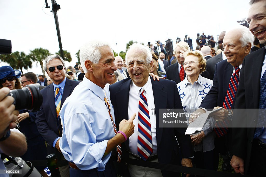 Former Florida Gov. Charlie Crist poses with his father, Charles Joseph Crist, Sr., after announcing that he will run for Governor as a Democrat on November 4, 2013 at Albert Whitted Park in St. Petersburg, Florida. Crist served as Florida's 44th governor as a Republican from 2007 to 2011.