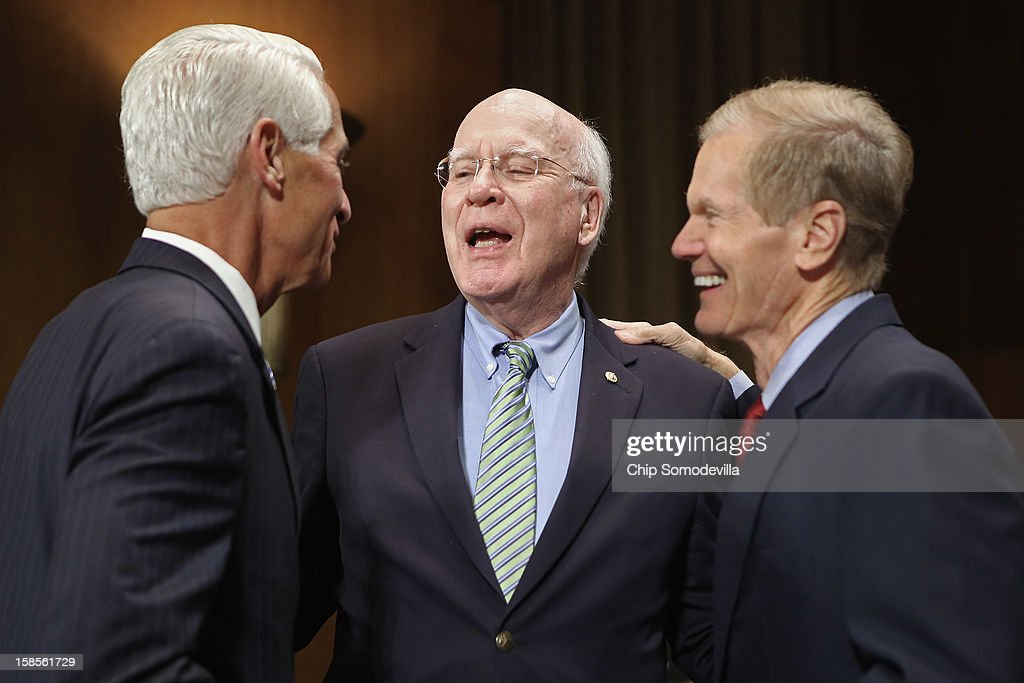 Former Florida Gov. Charlie Crist, Senate Judiciary Committee Chairman Patrick Leahy (D-VT) and U.S. Sen. Bill Nelson (D-FL) talk before a committee hearing on voting rights at the Dirksen Senate Office Building on Capitol Hill December 19, 2012 in Washington, DC. According to the committee, the hearing focused on Americans' access to the voting booth 'and the continuing need for protections against efforts to limit or suppress voting.'