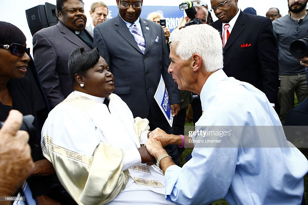 Former Florida Gov. <a gi-track='captionPersonalityLinkClicked' href=/galleries/search?phrase=Charlie+Crist&family=editorial&specificpeople=753543 ng-click='$event.stopPropagation()'>Charlie Crist</a> speaks with Rev. E.H. Brown of Ft. Lauderdale after announcing that he will run for Governor as a Democrat on November 4, 2013 at Albert Whitted Park in St. Petersburg, Florida. Crist served as Florida's 44th governor as a Republican from 2007 to 2011.