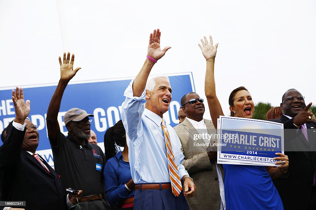 Former Florida Gov. <a gi-track='captionPersonalityLinkClicked' href=/galleries/search?phrase=Charlie+Crist&family=editorial&specificpeople=753543 ng-click='$event.stopPropagation()'>Charlie Crist</a> waves to the crowd before announcing that he will run for Governor as a Democrat on November 4, 2013 at Albert Whitted Park in St. Petersburg, Florida. Crist served as Florida's 44th governor as a Republican from 2007 to 2011.