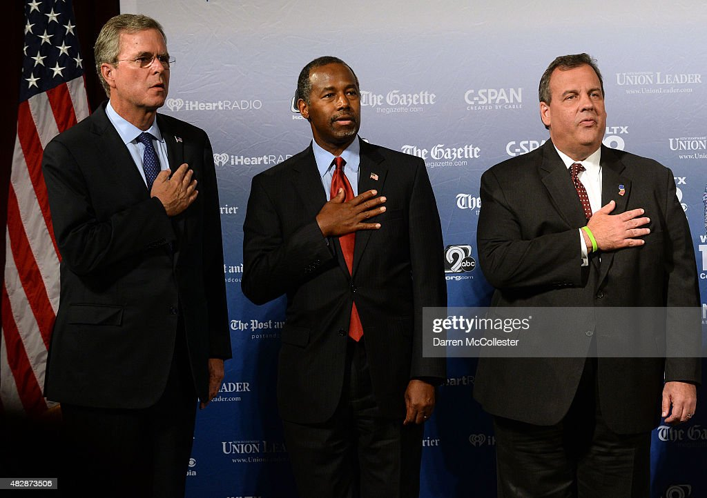 Former Florida Gov. Jeb Bush, Dr. Ben Carson,\ and New Jersey Gov. Chris Christie stand on the stage prior to the Voters First Presidential Forum for Republicans at Saint Anselm College August 3, 2015 in Manchester, New Hampshire. The forum was organized by the New Hampshire Union Leader newspaper and C-SPAN in response to the Fox News debate later this week that will limit the candidates to the top 10 Republicans based on nationwide polls.