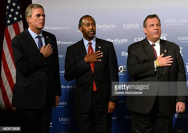 Former Florida Gov Jeb Bush Dr Ben Carson and New Jersey Gov Chris Christie stand on the stage prior to the Voters First Presidential Forum for...