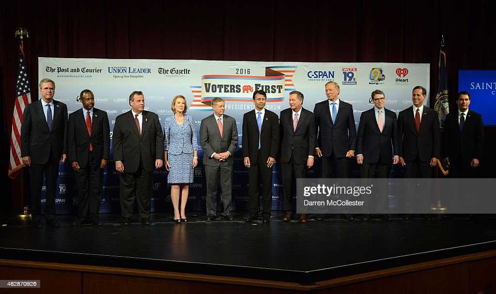 Former Florida Gov. Jeb Bush, Dr. Ben Carson, New Jersey Gov. Chris Christie, former CEO Hewlett-Packard Carly Fiorina, U.S. Senator Lindsey Graham (SC), Louisiana Gov. Bobby Jindal, Ohio Gov. John Kasich, former New York Gov. George Pataki, former Texas Gov. Rick Perry, former U.S. Senator Rick Santorum (PA), Wisconsin Gov. Scott Walker stand on the stage prior to the Voters First Presidential Forum for Republicans at Saint Anselm College August 3, 2015 in Manchester, New Hampshire. The forum was organized by the New Hampshire Union Leader and C-SPAN in response to the Fox News debate later this week that will limit the candidates to the top 10 Republicans based on nationwide polls.