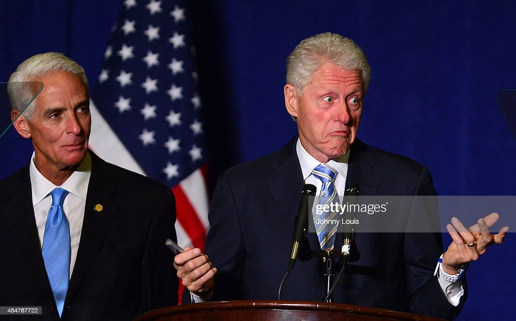 Former Florida Governor and current Democratic Party candidate for Governor Charlie Crist and former U.S. President Bill Clinton speak at Crist's campaign rally at JW Marriott Marquis on September 5, 2014 in Miami, Florida.