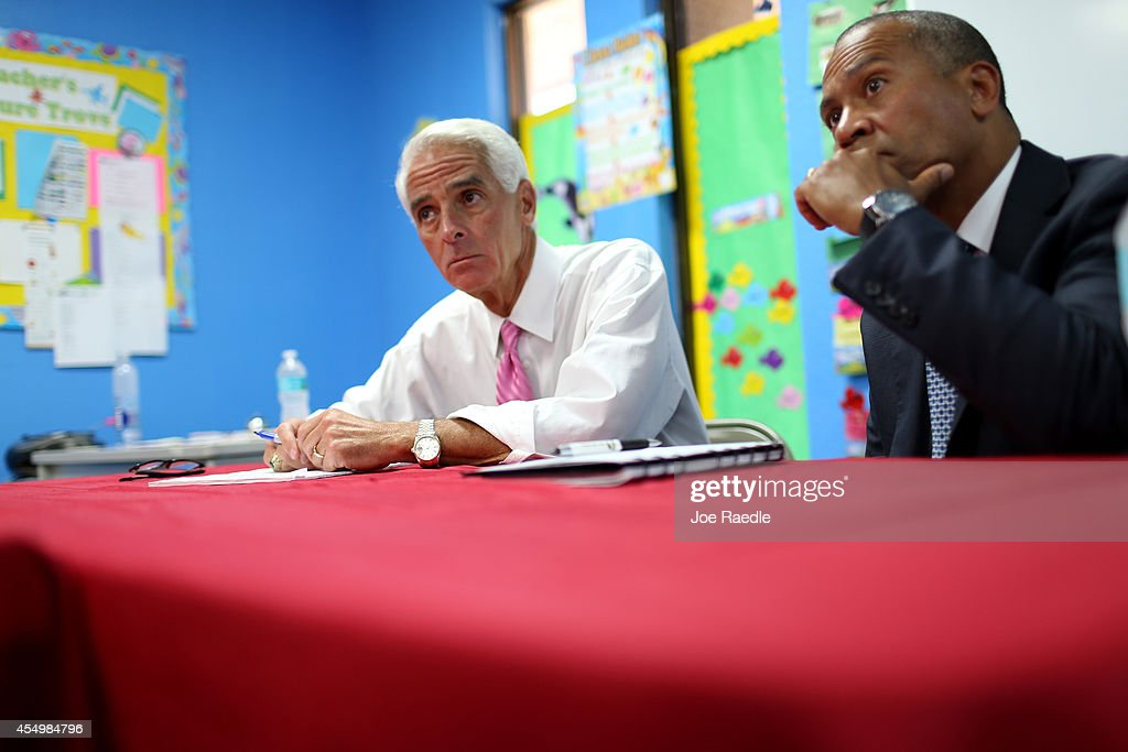 Former Florida Governor and current Democratic Party candidate for Governor Charlie Crist sits with Massachusetts Governor Deval Patrick during a...