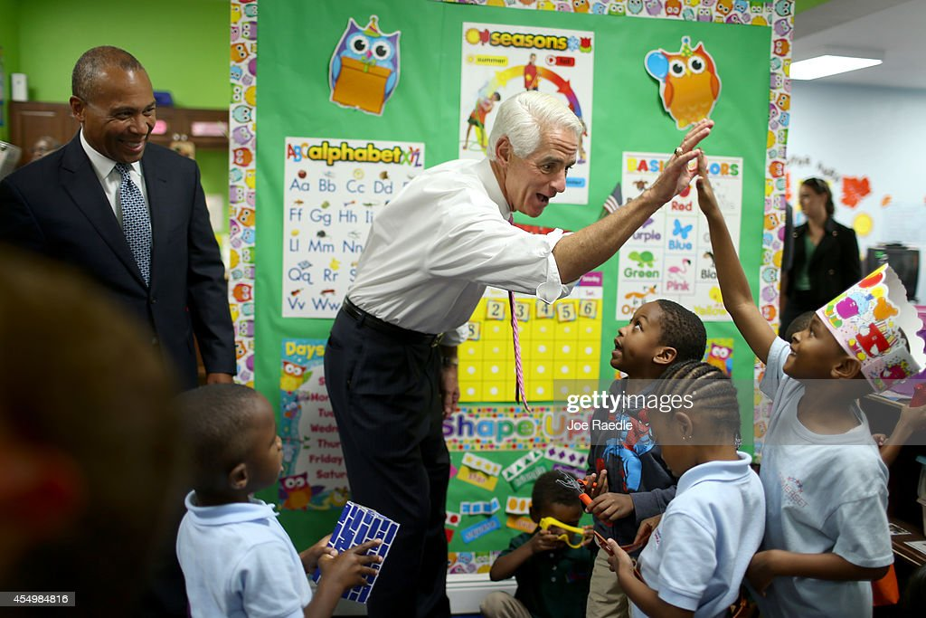 Former Florida Governor and current Democratic Party candidate for Governor Charlie Crist and Massachusetts Governor Deval Patrick greet children...