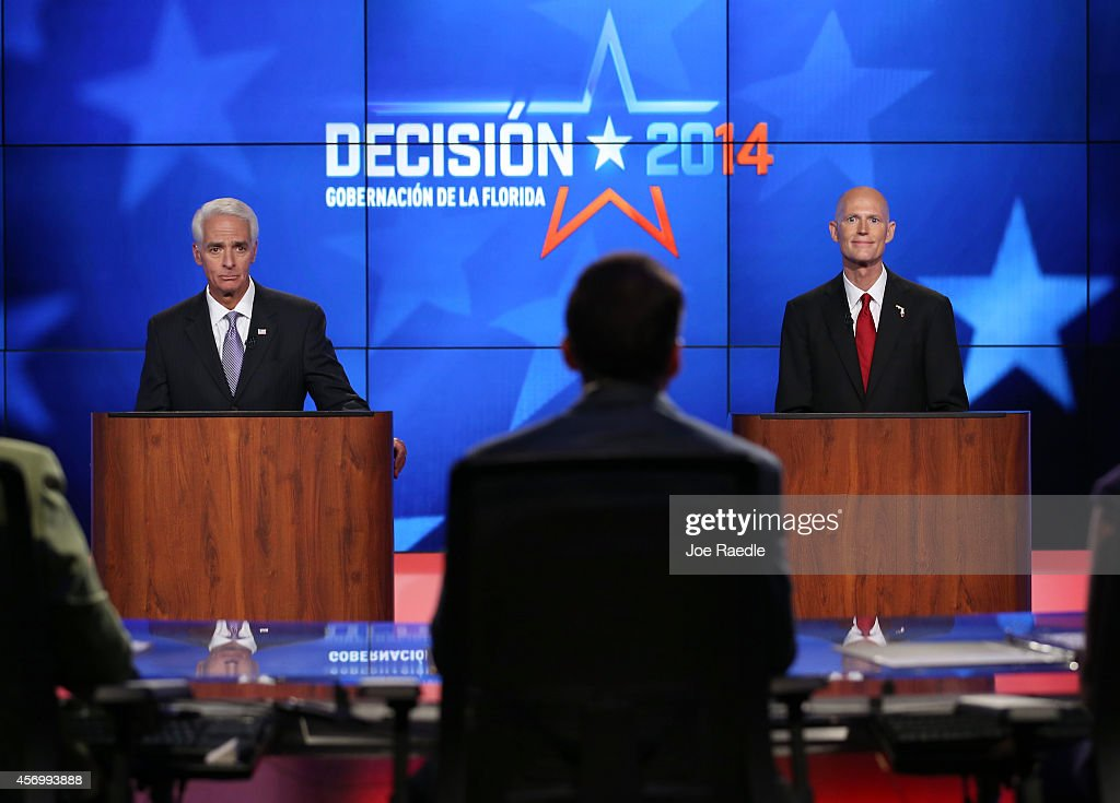Former Florida Governor and Democratic candidate for Governor Charlie Crist (L) and Republican Florida Governor Rick Scott are seen during their debate on NBCUniversal/Telemundo 51 on October 10, 2014 in Miramar, Florida. Governor Scott is facing off against Crist in the November 4, 2014 governors race.