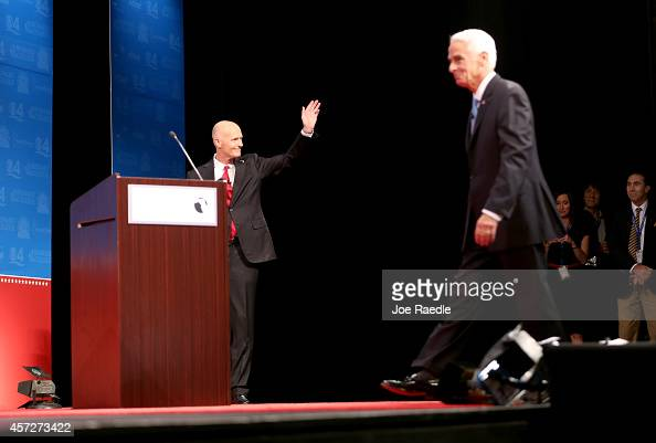Former Florida Governor and Democratic candidate for Governor Charlie Crist walks back to his podium as Republican Florida Governor Rick Scott enters...