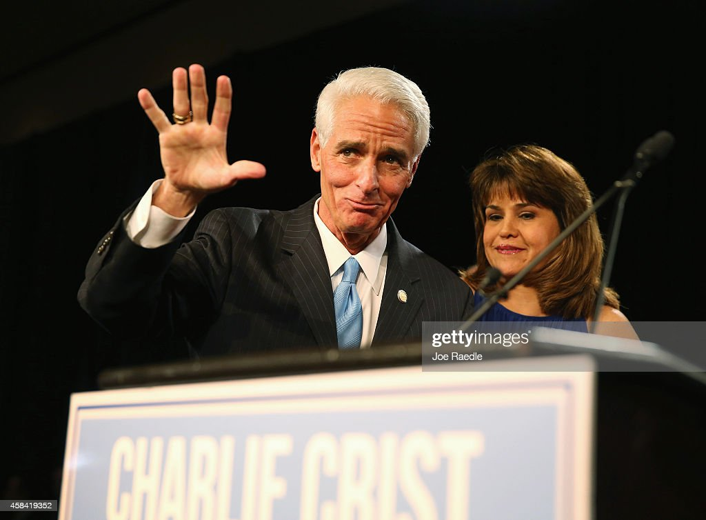 Former Florida Governor and Democratic gubernatorial candidate <a gi-track='captionPersonalityLinkClicked' href=/galleries/search?phrase=Charlie+Crist&family=editorial&specificpeople=753543 ng-click='$event.stopPropagation()'>Charlie Crist</a> waves as he stands with <a gi-track='captionPersonalityLinkClicked' href=/galleries/search?phrase=Annette+Taddeo&family=editorial&specificpeople=13549312 ng-click='$event.stopPropagation()'>Annette Taddeo</a>, his Democratic lieutenant governor candidate, after they conceded defeat in the Vinoy hotel on November 4, 2014 in St. Petersburg, Florida. Crist lost to incumbent Republican Governor Rick Scott.