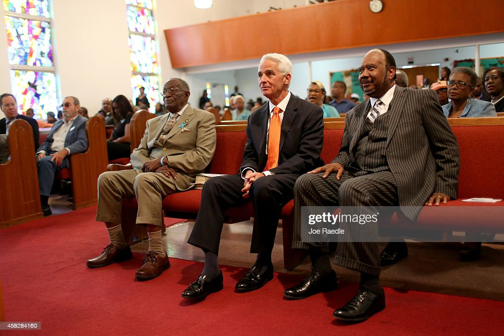 Former Florida Governor and now Democratic gubernatorial candidate Charlie Crist sits with Pastor Lenard C Johnson as he waits to be introduced to...