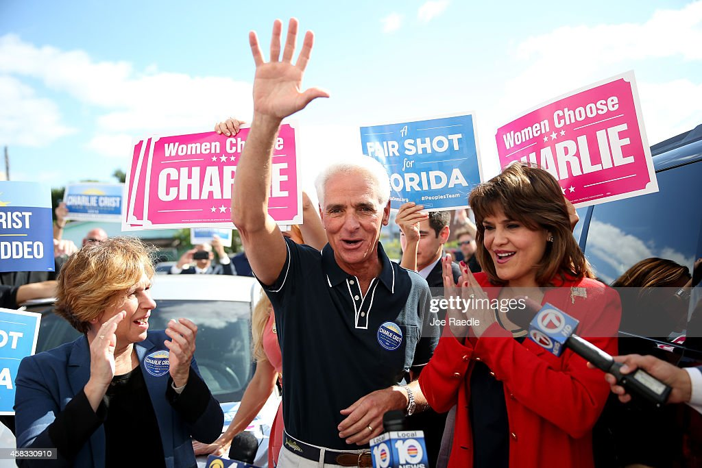 Former Florida Governor and now Democratic gubernatorial candidate <a gi-track='captionPersonalityLinkClicked' href=/galleries/search?phrase=Charlie+Crist&family=editorial&specificpeople=753543 ng-click='$event.stopPropagation()'>Charlie Crist</a> stands with <a gi-track='captionPersonalityLinkClicked' href=/galleries/search?phrase=Annette+Taddeo&family=editorial&specificpeople=13549312 ng-click='$event.stopPropagation()'>Annette Taddeo</a> (R), his Democratic lieutenant governor candidate and Randi Weingarten (L) , American Federation of Teachers president, as he makes a campaign stop at the International brotherhood of Electrical workers Hall on November 3, 2014 in Miami, Florida. Crist is facing off against incumbent Republican Governor Rick Scott in the November 4, 2014 election.