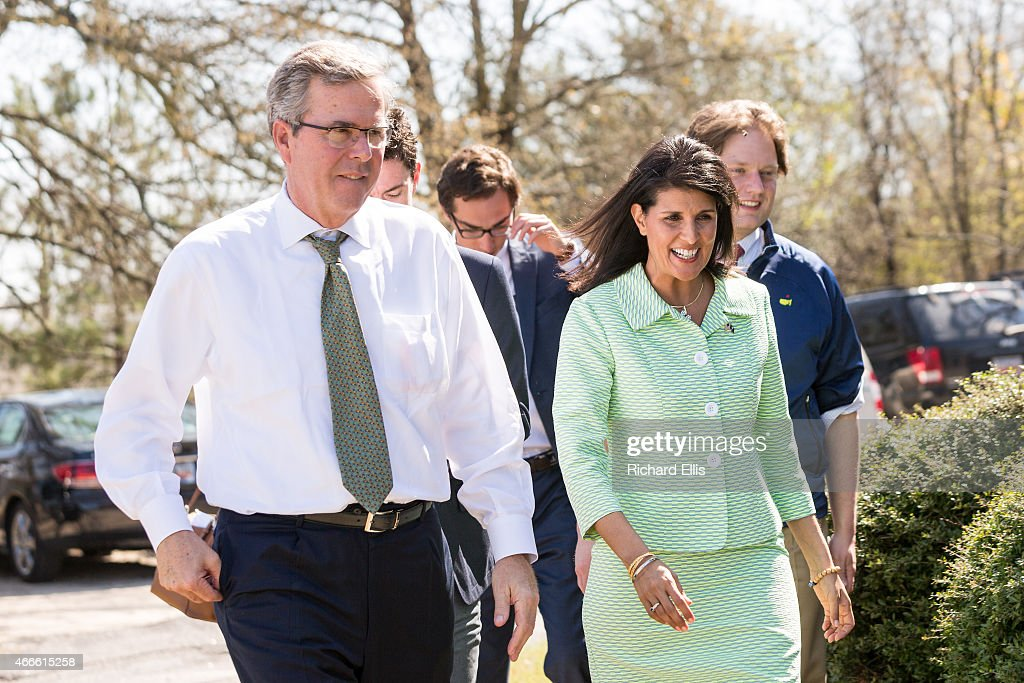Former Florida Governor and potential GOP presidential candidate Jeb Bush walks with South Carolina Governor Nikki Haley during a visit to Sistercare...