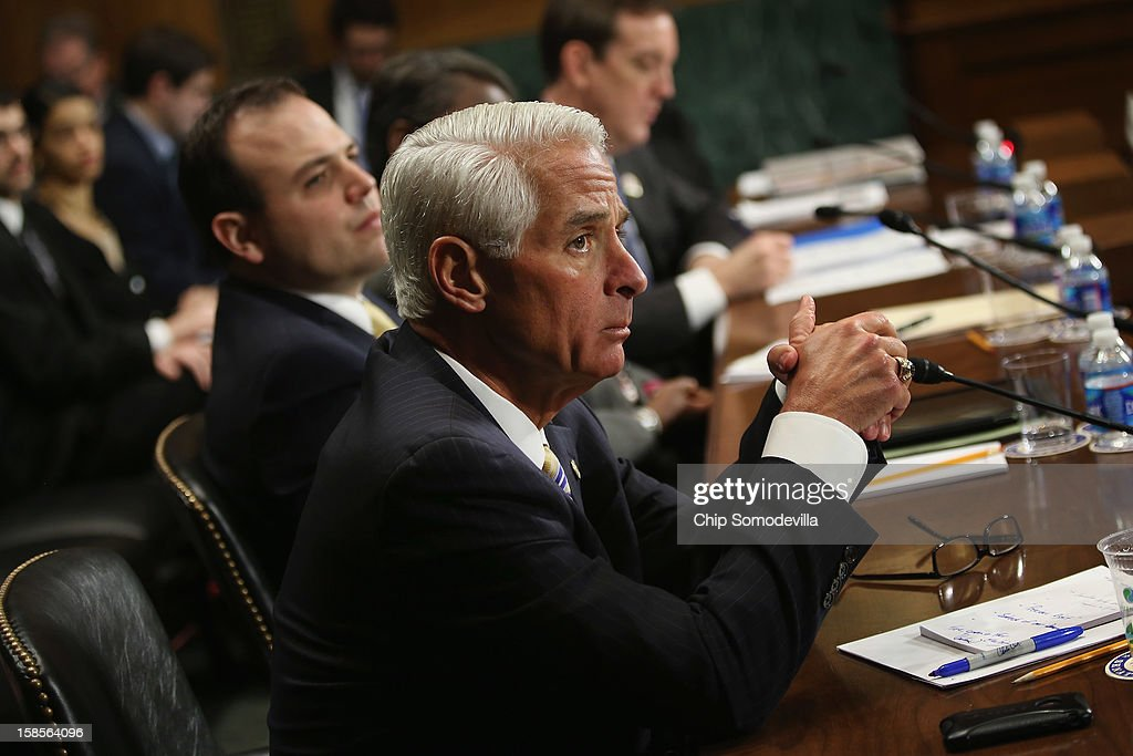 Former Florida Governor <a gi-track='captionPersonalityLinkClicked' href=/galleries/search?phrase=Charlie+Crist&family=editorial&specificpeople=753543 ng-click='$event.stopPropagation()'>Charlie Crist</a> (L) testifies before the Senate Judiciary Committee hearing on voting rights at the Dirksen Senate Office Building on Capitol Hill December 19, 2012 in Washington, DC. According to the committee, the hearing focused on Americans' access to the voting booth 'and the continuing need for protections against efforts to limit or suppress voting.'