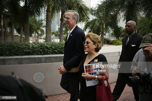 Former Florida Governor Jeb Bush and possible Republican presidential candidate walks with his wife Columba Bush as they arrive to present awards to...
