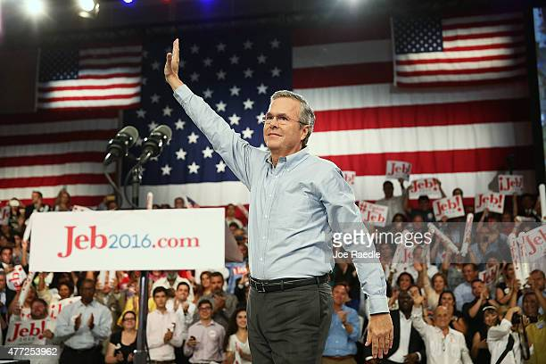 Former Florida Governor Jeb Bush waves as he walks on stage to announce his candidacy for the Republican presidential nomination during an event at...