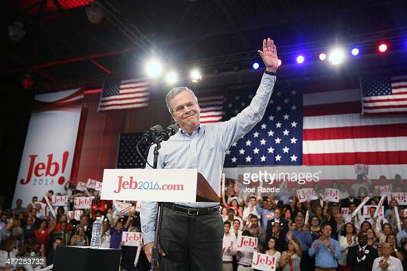 Former Florida Governor Jeb Bush waves on stage as he announces his candidacy for the Republican presidential nomination during an event at MiamiDade...