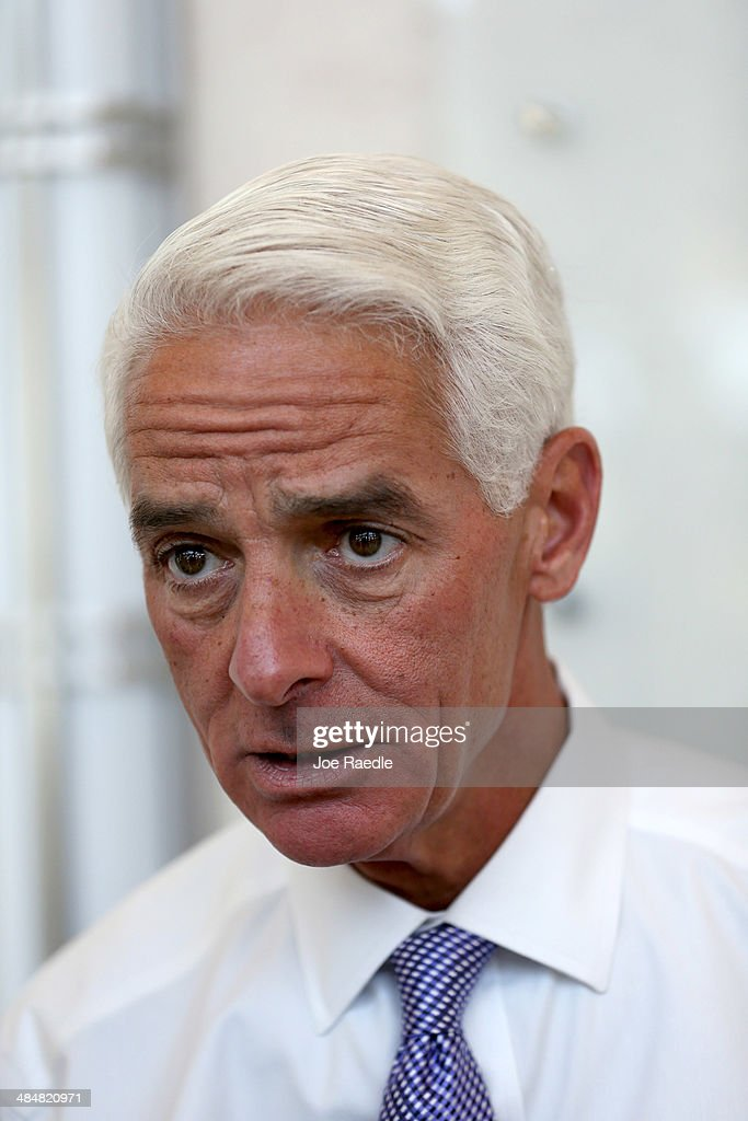 Former Florida Republican Governor <a gi-track='captionPersonalityLinkClicked' href=/galleries/search?phrase=Charlie+Crist&family=editorial&specificpeople=753543 ng-click='$event.stopPropagation()'>Charlie Crist</a>, who is currently the leading Democrat trying to unseat incumbent Republican Gov. Rick Scott, is seen as he visits the Forum Club of the Palm Beaches held in the Cohen Pavilion at the Kravis Center on April 14, 2014 in West Palm Beach, Florida. The former governor is showing a slight edge in the polls over Rick Scott as the campaign starts to heat up for the 2014 Florida gubernatorial election that will take place on November 4, 2014.