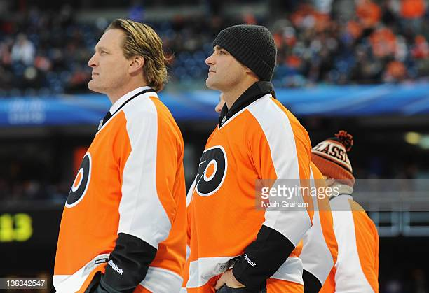 Former Flyer Jeremy Roenick and Eric Lindros look on during opening ceremonies prior to the game against the New York Rangers during the 2012...