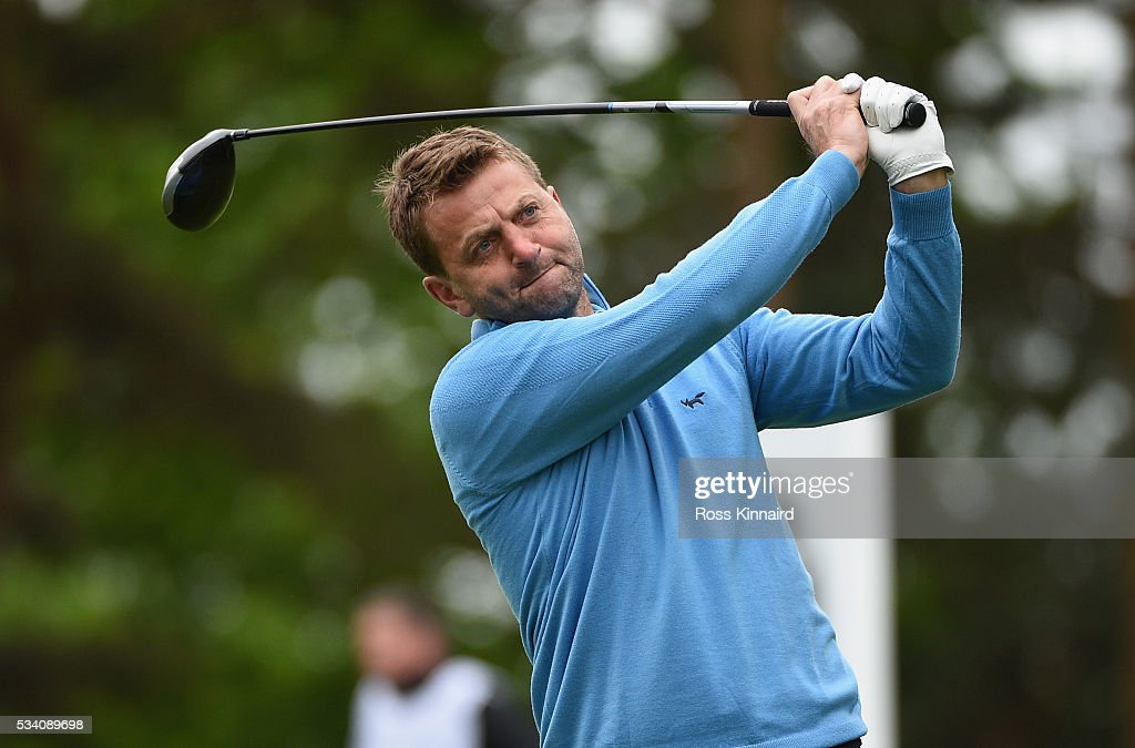 Former footbaler Tim Sherwood tees off during the Pro-Am prior to the BMW PGA Championship at Wentworth on May 25, 2016 in Virginia Water, England.