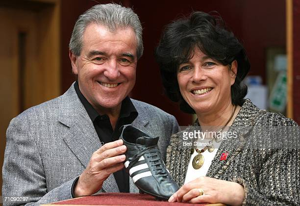 Former football manager Terry Venables and Stephanie Moore pose with a bronze cast of one of Bobby Moore's 1966 World Cup football boots to be sold...