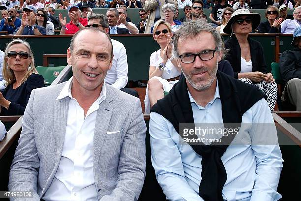 Former Football player Alain Boghossian and PSG Football Team Coach Laurent Blanc attends the 2015 Roland Garros French Tennis Open Day Five on May...