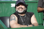 Former football player and coach Diego Armando Maradona enjoys the second Davis Cup semifinal match between Monaco and Berdych of Argentina and Czech...
