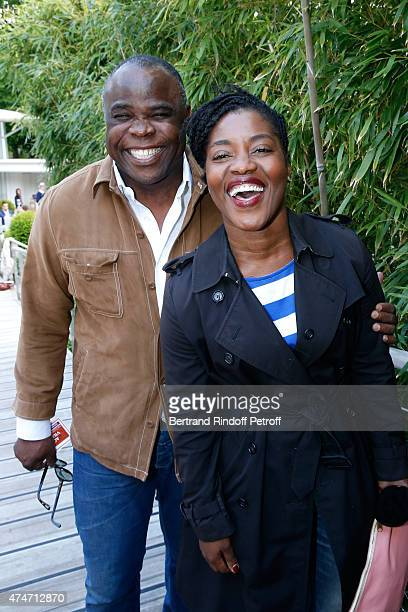 Former Football player Basile Boli and Humorsit Claudia Tagbo attend the 2015 Roland Garros French Tennis Open Day 2 on May 25 2015 in Paris France