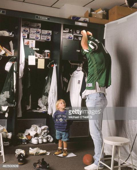 Former football player Boomer Esiason is photographed with son Gunnar for Sports Illustrated on September 20 1993 at Hofstra University in Hempstead...