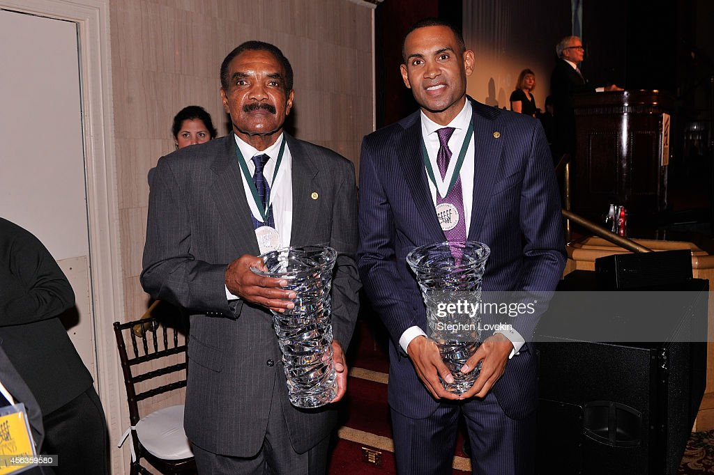 Former football player Calvin Hill (L) and former basketball player <a gi-track='captionPersonalityLinkClicked' href=/galleries/search?phrase=Grant+Hill+-+Basketball+Player&family=editorial&specificpeople=201658 ng-click='$event.stopPropagation()'>Grant Hill</a> pose at the 29th Annual Great Sports Legends Dinner to benefit The Buoniconti Fund to Cure Paralysis at The Waldorf Astoria on September 29, 2014 in New York City.