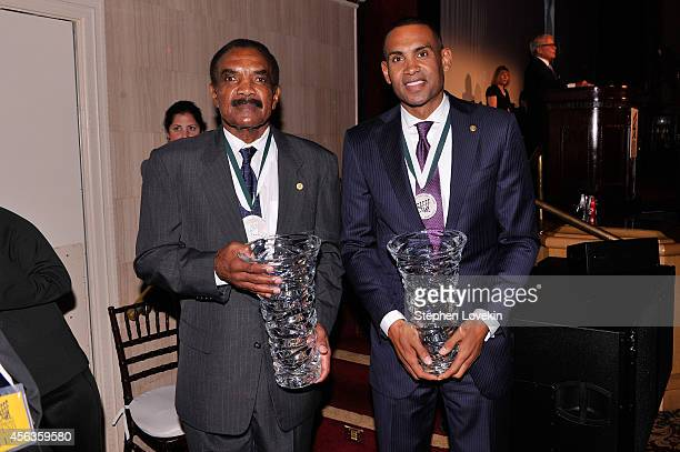 Former football player Calvin Hill and former basketball player Grant Hill pose at the 29th Annual Great Sports Legends Dinner to benefit The...