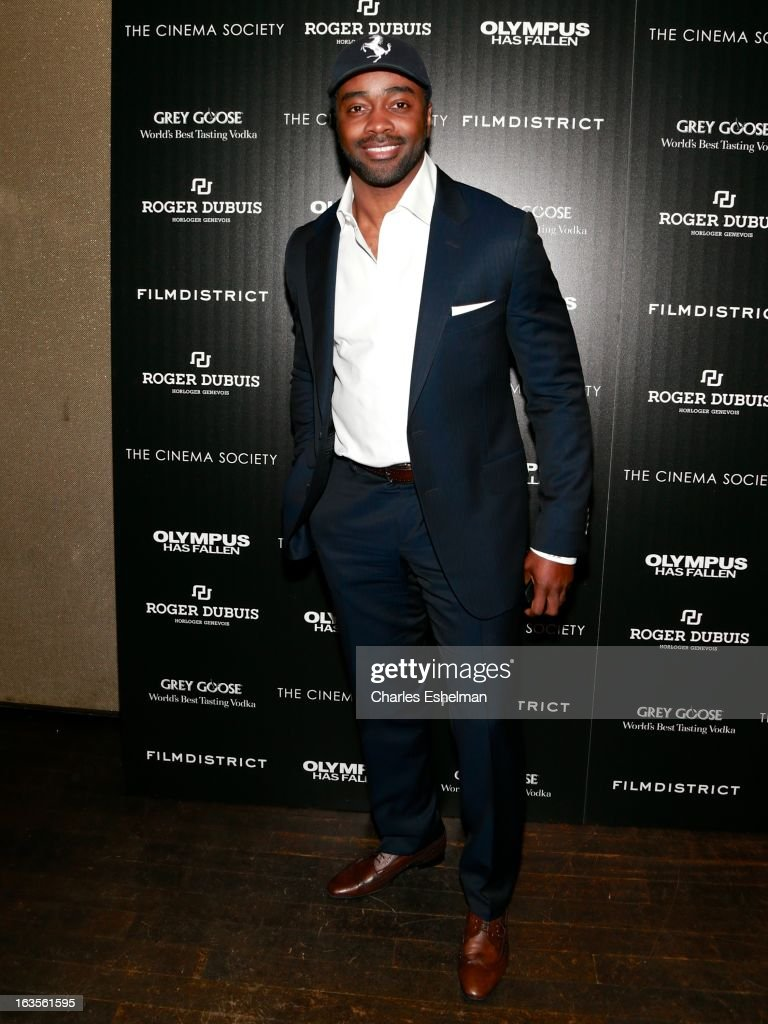 Former football player Curtis Martin attends The Cinema Society with Roger Dubuis and Grey Goose screening of FilmDistrict's 'Olympus Has Fallen' at the Tribeca Grand Screening Room on March 11, 2013 in New York City.