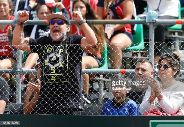 Former football player Diego Maradona cheers for his team during a singles match between Guido Pella and Fabio Fognini as part of day 3 of the Davis...