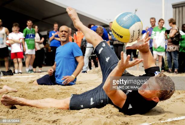 Former football player Dirk Kuyt plays sitting beach volleyball during the first edition of his Dirk Kuyt Foundation Champions Day in Katwijk on June...