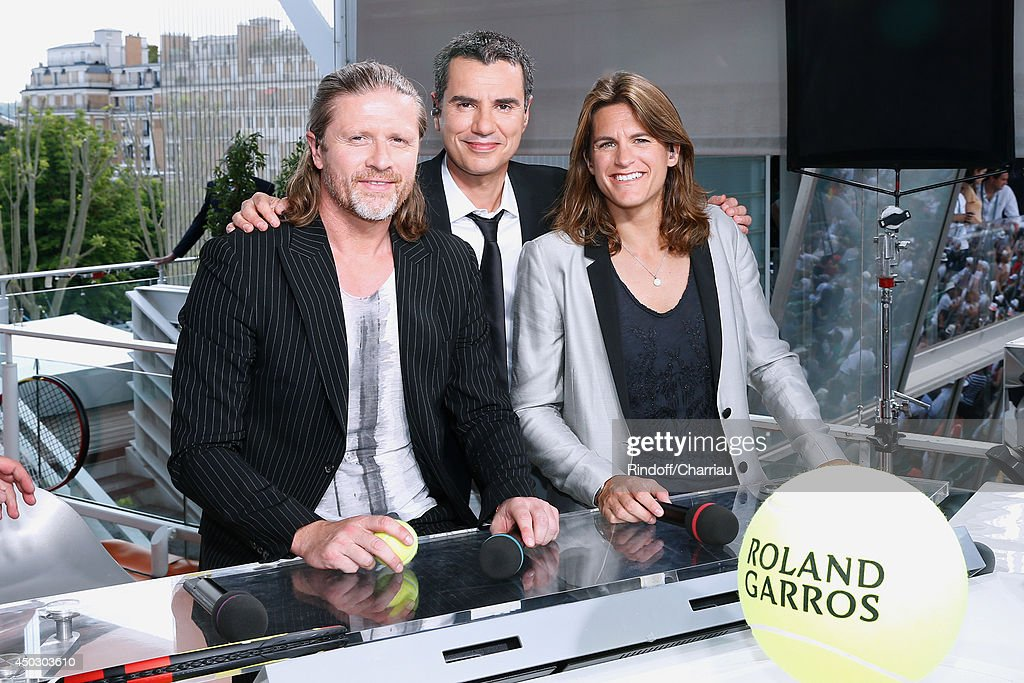Former football player Emmanuel Petit, Sports journalist Laurent Luyat and former tennis player and TV host Amelie Mauresmo pose at France Television french chanels studio whyle the Men's Final of Roland Garros French Tennis Open 2014 - Day 15 on June 8, 2014 in Paris, France.
