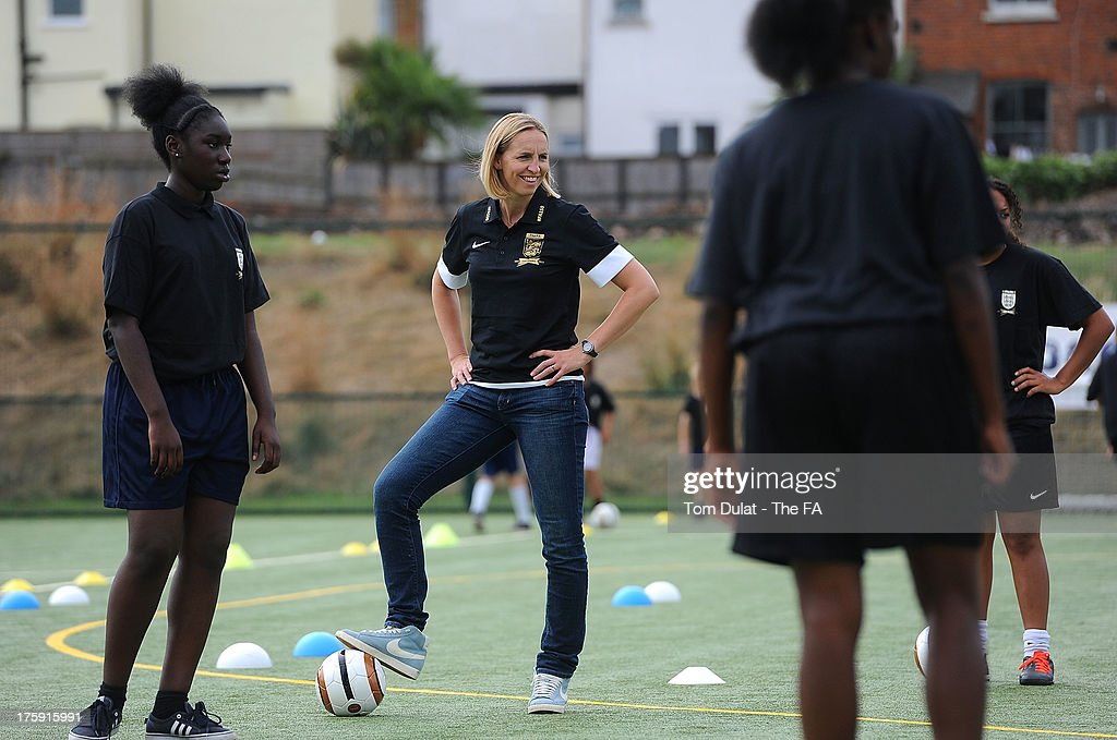 Former football player <a gi-track='captionPersonalityLinkClicked' href=/galleries/search?phrase=Faye+White&family=editorial&specificpeople=171388 ng-click='$event.stopPropagation()'>Faye White</a> takes part in activities during The FA's Sir Bobby Robson National Football Day at Kings College Sports Ground on August 10, 2013 in London, England.