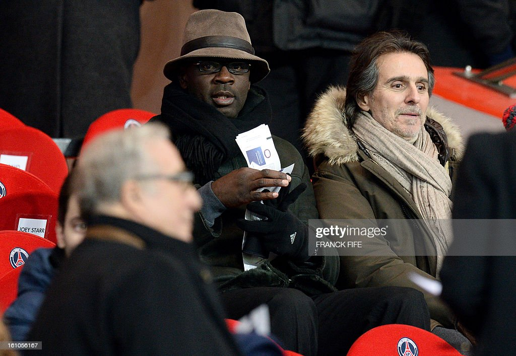Former football player France's Lilian Thuram (C) is seen prior to the French L1 football match Paris Saint-Germain (PSG) vs Bastia, on February 8, 2013 at the Parc des Princes stadium in Paris. AFP PHOTO / FRANCK FIFE