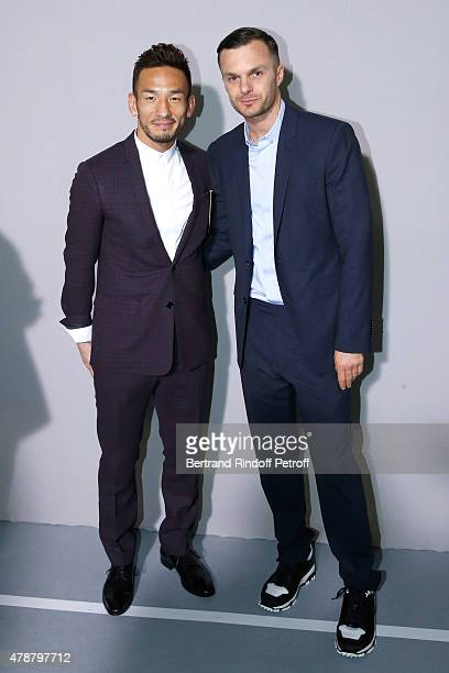 Former Football Player Hidetoshi Nakata and Fashion designer Kris Van Assche pose Backstage after the Dior Homme Menswear Spring/Summer 2016 show as...