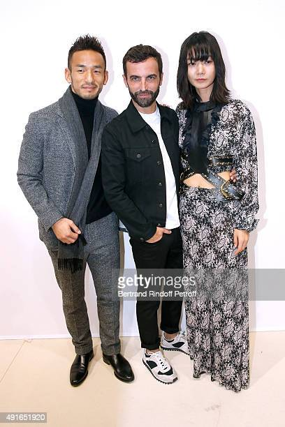 Former Football Player Hidetoshi Nakata Fashion Designer Nicolas Ghesquiere and Actress Doona Bae pose Backstage after the Louis Vuitton show as part...