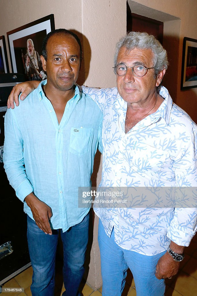 Former football player <a gi-track='captionPersonalityLinkClicked' href=/galleries/search?phrase=Jean+Tigana&family=editorial&specificpeople=227193 ng-click='$event.stopPropagation()'>Jean Tigana</a> and Artistic Director of the Festival <a gi-track='captionPersonalityLinkClicked' href=/galleries/search?phrase=Michel+Boujenah&family=editorial&specificpeople=1027167 ng-click='$event.stopPropagation()'>Michel Boujenah</a> 'Pianistic' Concert of singer Julien Clerc at at 29th Ramatuelle Festival : Day 4 on August 3, 2013 in Ramatuelle, France.
