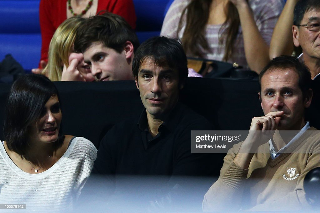 Former football player Robert Pires (C) watches the action during the men's singles match between Novak Djokovic of Serbia and Jo-Wilfried Tsonga of France on day one of the ATP World Tour Finals at the O2 Arena on November 5, 2012 in London, England.