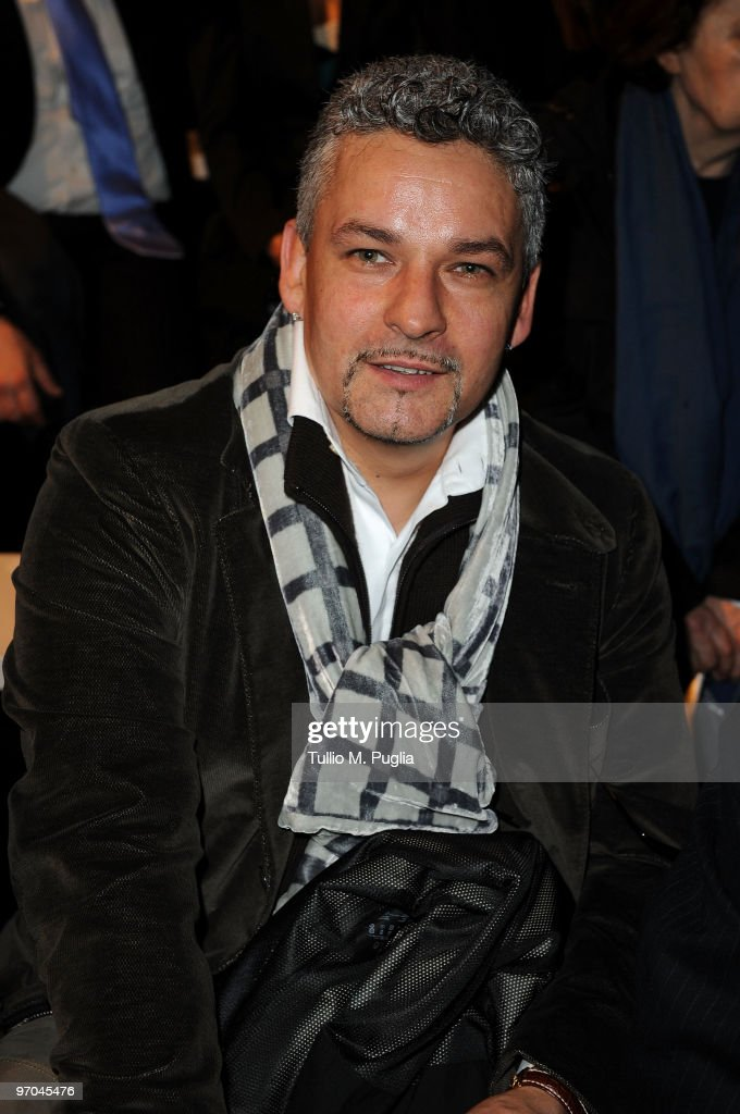 Former football player <a gi-track='captionPersonalityLinkClicked' href=/galleries/search?phrase=Roberto+Baggio&family=editorial&specificpeople=216586 ng-click='$event.stopPropagation()'>Roberto Baggio</a> attends the Luciano Soprani Milan Fashion Week Womenswear Autumn/Winter 2010 show on February 25, 2010 in Milan, Italy.